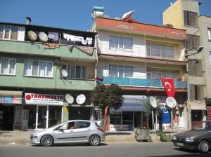 Today: Main street in Mustafakemalpasa, Turkey, brimming with cars, cell phones, solar panels and satellite dishes. (2010)