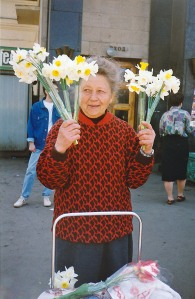 Flower lady sells daffodils, making ends meet. (Moscow, Russia 1993)