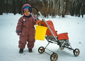 Shy toddler strolls in Moscow park near my apartment. (Moscow, Russia Dec 1993)