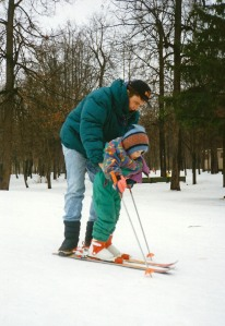 Father guides daughter--her first time on skis--in park outside my apartment. (Moscow, Russia Jan 1994)