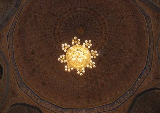Intricate tiles and chandeliers inside an Uzbek mosque <br>Photo credit: Helen Holter</br>