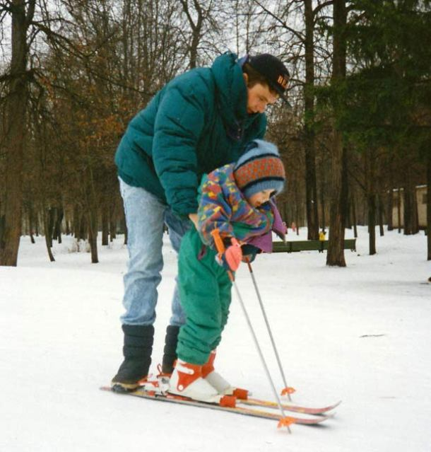 A father guides his daughter – her first time on skis – in a snowy park outside my apartment in Moscow, Russia Photo credit: Helen Holter </br> Jan 1994