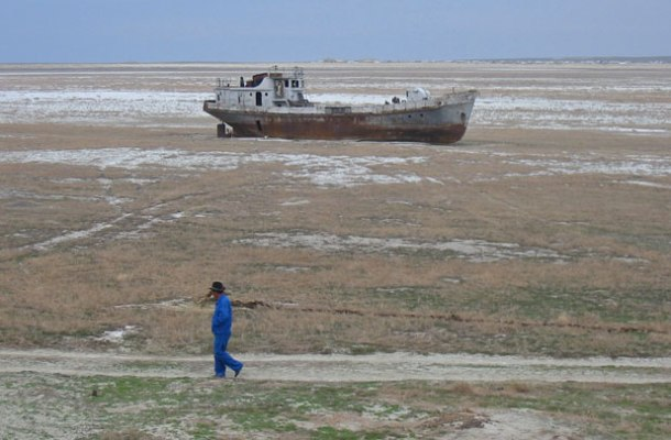 Orphaned ship in former Aral Sea in Karakalpakstan, Uzbekistan <br>Photo credit: Public domain, Wikimedia Commons</br>